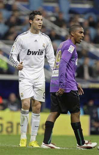 Real Madrid's Cristiano Ronaldo of Portugal, left, and Malaga's Patrick Jan Mtiliga from Denmark are seen during a Spanish La Liga soccer match at the Santiago Bernabeu stadium in Madrid, Sunday. Ronaldo scored both goals in a 2-0 win over Malaga but was later red-carded for deliberately elbowing Patrick Jan Mtiliga in the face. AP