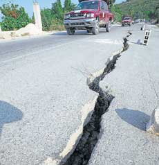 Deep fissures: The road to Leogane from Port-au-Prince shows damages in several places following the earthquake. NYT image