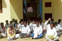 The villagers of Arooru and surrounding villages staging a protest in front of the Forest  Department office in Chikkaballapur on Monday alleging trespass by Forest officials into  their fields. dh photo