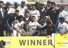 Indian cricketers pose with the Test series trophy at the end of the second Test match between Bangladesh and India at The Sher-e Bangla National Stadium in Dhaka on Wednesday. AFP