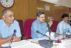 B S Ramprasad, Kolar District in-charge Secretary, Zilla Panchayat Chief Executive Officer G V Ranga Rao, and Deputy Commissioner N Prabhakar are seen at the progress review meeting in Kolar on Wednesday. DH PHOTO