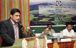 : State Biodiversity Board Vice-Chairman Anil Kumble speaking at the Scientists Conference on Conservation of Western Ghats in Karnataka in Bangalore on Thursday. The programme was organised by Western Ghats Task Force and Karnataka Forest Department. Prof DK Subramanyam and Environment Minister Krishna Palemar are seen. dh photo