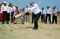 Secretary of Karnataka State Cricket Association Brijesh Patel inaugurating a turf wicket at Manipal Univertsity by batting, while Manipal University Pro-Chancellor Dr H S Ballal (behind) plays the wicket keeper, in Manipal on Friday. DH photo