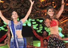 Isha Sherwani and model Gauhar Khan perform during the inauguration of 'kingdom of dreams' at the Great India Nautanki Company, a world class opera house, in Gurgaon on Friday. PTI