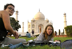 Tourists sit on the lawns of the Taj Mahal in Agra. File photo/AP