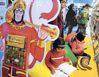 Children read books at a stall at the World Book Fair 2010 in New Delhi on Saturday. The 19th New Delhi World Book Fair is open till February 7. AFP