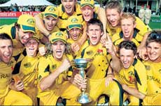 Champions: The victorious Australian team poses with the under-19 World Cup in Lincoln, New Zealand on Saturday. AFP