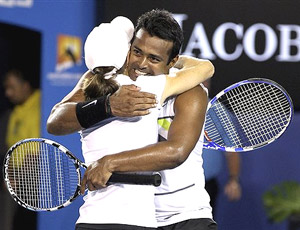 Cara Black of Zimbabwe and Leander Paes of India celebrates after beating Ekaterina Makarova of Russia and Jaroslav Levinsky of Czech Republic to win the Mixed doubles final match at the Australian Open tennis championship in Melbourne on Sunday. AP