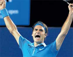 CRY OF JOY: Roger Federer celebrates his win over Andy Murray in the final of the Australian Open in Melbourne on Sunday. AP