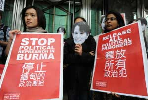 The coalition for a free Burma protest outside the Cheung Kong Centre in Hong Kong on February 5, 2010. AFP