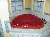 The heart-shaped Jacuzzi is designed for two.