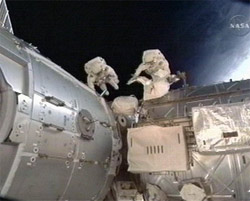 This image taken from video and made available by NASA shows astronauts Robert Behnken and Nicholas Patrick during their spacewalk as they work outside the International Space Station on Saturday. AP