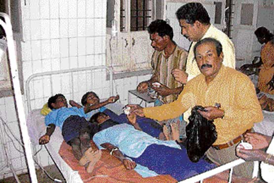 Students undergoing treatment at Primary Health Centre in Kannampalli of Bagepalli taluk.dh photo