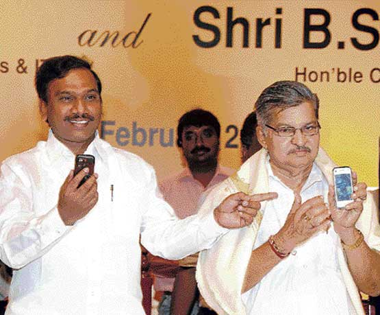 Union Communication and IT Minister  A Raja and Home Minister V S Acharya displaying the 3G  mobile phones at the launch of the BSNL 3G mobile services in Bangalore on Friday. dh Photo