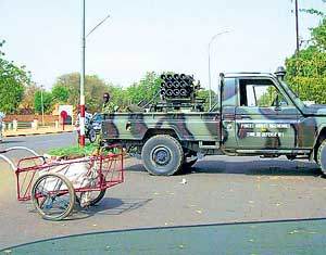 Niger armed forces personnel block the road with a vehicle in Niamey on Friday. AFP