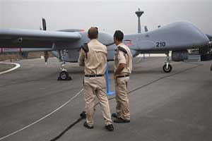 Israeli soldiers stand next to an unmanned plane in the Tel Nof base, in central Israel on Sunday. AP
