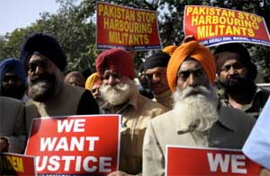 Members of the Shiromani Akali Dal (Badal) hold placards during a protest against the killing of a Sikh in Pakistan, near the Pakistan Embassy in New Delhi on February 23, 2010. AFP
