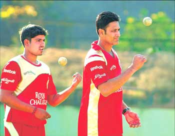 Royal Challengers' skipper Anil Kumble (right) and Karan Sharma during a training session on Monday. DH PHOTO
