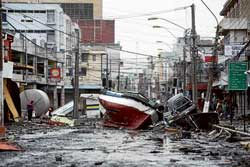 A boat lies marooned on a street in Talcahuano, Chile, on Monday, after an 8.8-magnitude earthquake on Saturday triggered a tsunami. AP