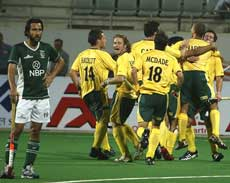 South African players celebrate after scoring a goal against Pakistan as Pakistani player Shakeel Abbasi (left) watches during the World Cup hockey match in New Delhi on Saturday. AP