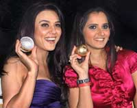Actress Preity Zinta and tennis star Star Sania Mirza strike a pose with medallions during a ceremony organised by 'Sports Illustrated' to felicitate the most influential people in Indian sports in Mumbai. PTI