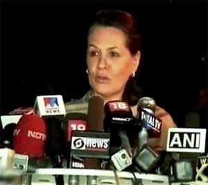 UPA chairperson Sonia Gandhi addresses media at her residence in New Delhi on Tuesday. PTI / TV Grab