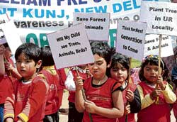 Schoolchildren hold placards as they take part in a rally to protest against rampant pollution near the India Gate in New Delhi on Wednesday. AFP