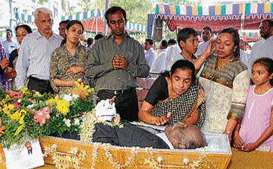 Meena Rebimbus paying last respects to the mortal remains of her husband Wilfy Rebimbus at St Joseph's Seminary premises in Mangalore on Thursday. Wilfy's son Vishwas, daughter Veena and other family members look on.