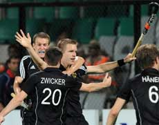 German hockey player Linus Butt (C) celebrates with teammates after scoring a goal against England during their World Cup 2010 semifinal match at the Major Dhyan Chand Stadium in New Delhi on Thursday. AFP