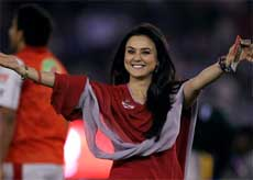 Kings XI Punjab co-owner Priety Zinta gestures towards her fans before the start of the IPL T20 match against Delhi Daredevils at Mohali on Saturday. PTI