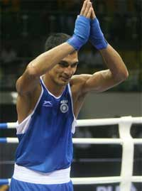 Indian boxer Jai Bhagwan reacts after beating Scotland's boxerJosh Taylor the quarterfinal bout in the Light weight 60 kg. category, during the 5th Commonwelth Boxing Championship in New Delhi on Sunday. PTI