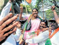 Exuberant: BJP supporters celebrating during nomination filing at Shivajinagar BBMP office, Queen's Road  in Bangalore on Monday. DH Photo
