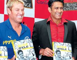 LENS VIEW: Royal Challengers Bangalore skipper Anil Kumble and Rajasthan Royals captain Shane Warne hold the former's book Wide Angle in Bangalore on Wednesday. DH photo