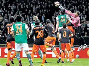 THWARTING DANGER: Valencia's goalkeeper Cesar Sanchez (right) punches away a cross during their Europa League last-16 match against Werder Bremen on Thursday. REUTERS