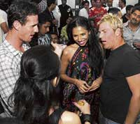 enjoying Shane Warne surrounded by guests.