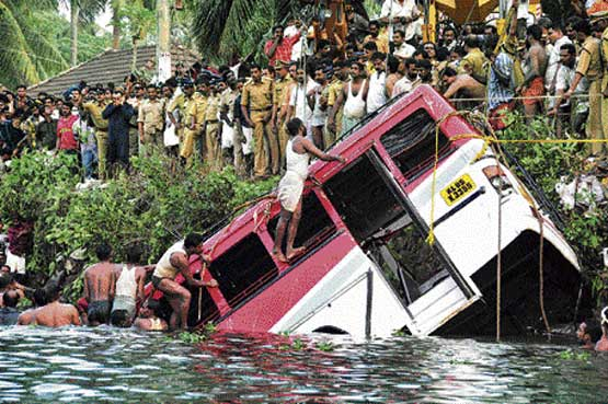 Rescuers at work to lift a bus which plunged into the Meenachil river near Kottayam in Kerala on Tuesday. At least eleven persons, including two women, drowned and more are feared trapped in the bus. PTI