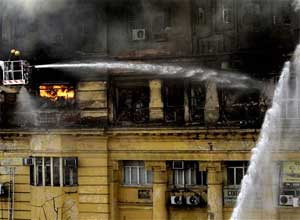 Firefighters spray water to douse fire at a building in Calcutta on Tuesday.AP