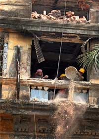 Demolition work underway at Stephen Court building in Kolkata on Thursday. PTI
