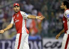 Kings XI Punjab's Yuvraj Singh (L) reacts after team mate Irfan Pathan drops a catch of Y Pathan of Rajasthan Royals during the Indian Premier League 3 match in Mohali on Wednesday. PTI
