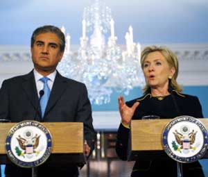 US Secretary of State Hillary Clinton (R) answers a question as Pakistani Foreign Minister Makhdoom Shah Mehmood Qureshi looks on during a press briefing following their bilateral meeting at the Department of State in Washington, DC, on Wednesday. AFP