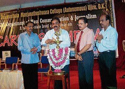 "Udayavani Editor Balakrishna Holla inaugurating the seminar on ""Career in media"" organised by the Department of PG Studies in Mass Communication and Journalism of SDM College in Ujire on Friday. Prof J Mahaveer, Dr B Yashovarma and Prof Bhaskar Hegde are seen. DH photo"