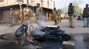 Security personnel keep vigil after communal clashes erupted at Gowliguda in Hyderabad on Sunday. PTI