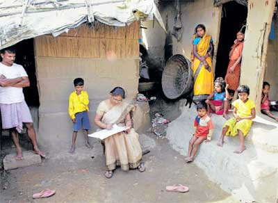 Massive task ahead: Mahesh Shah and his family members look on while census worker Rumima Das, collects the information on the first day of the national census at Ramsingh Chapori village, east of Guwahati on Thursday. India kicked off the national census of its billion-plus population on Thursday. AP