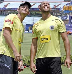 Deccan Chargers' skipper Adam Gilchrist with teammate Andrew Symonds. PTI
