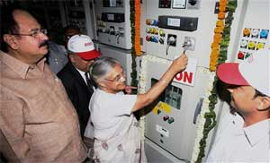 Delhi Chief Minister Sheila Dikshit dedicates a 66/11kv Grid for Commonwealth Games as Delhi Finance Minister A K Walia looks on, in New Delhi on Saturday. PTI