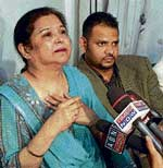 Farisha Siddiqui, mother of Ayesha, addresses a press conference in Hyderabad on Friday. PTI
