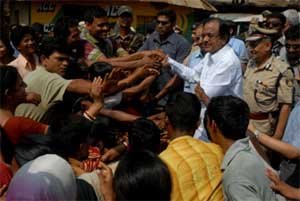 Home Minister P. Chidambaram (2R) shakes hands with villagers during a visit to Lalgarh, some 130kms west of Kolkata, on Sunday. AFP