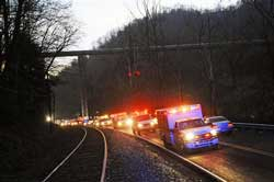 Emergency vehicles leave the entrance to Massey Energy's Upper Big Branch Coal Mine on Monday, in Montcoal, W.Virginia. after an explosion at the underground coal mine. AP Photo