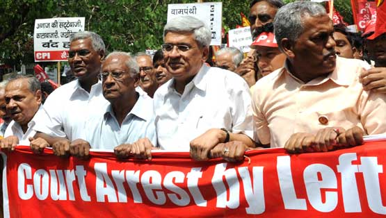 CPI-M General Secretary Prakash Karat (centre), CPI leaders A B Bardhan (third from left), A Raja (second from left) and left-wing activists march during a demonstration against price rise in New Delhi on Thursday. AFP
