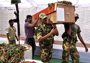 Security personnel carry the coffin of a CRPF soldier who was killed in Dantewada Maoists' attack, in Jagdalpur, Chhattisgarh on Wednesday. PTI